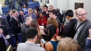 Reporters line up in hopes of attending a briefing in Press Secretary Sean Spicer's office at the White House in Washington, Friday, Feb. 24, 2017. White House held an off camera briefing in Spicer's office, where they selected who could attend. (AP Photo/Pablo Martinez Monsivais)