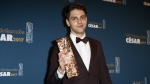 Canadian director Xavier Dolan poses with the Best Editing Cesar Award during the 42nd Cesar Film Awards ceremony at Salle Pleyel in Paris, Friday, Feb. 24, 2017. (AP / Francois Mori)