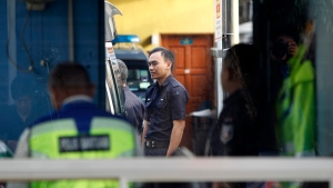 Police officers stay inside the guard post of the forensic department at Kuala Lumpur Hospital in Kuala Lumpur, Malaysia, Saturday, Feb. 25, 2017. (AP Photo/Daniel Chan)