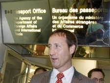 Foreign Affairs minister Peter MacKay looks at people lined up outside a passport office following a news conference announcing changes to reapplying for a Canadian passport, in Ottawa Friday June 8, 2007.(CP / Tom Hanson)