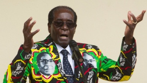 FILE - In this Dec, 17, 2016, file photo, Zimbabwean President Robert Mugabe addresses people at an event before the closure of his party's 16th Annual Peoples Conference in Masvingo, south of Harare. Zimbabwe. Mugabe is celebrating his 93rd birthday on Saturday, Feb. 25, 2017. (AP Photo/Tsvangirayi Mukwazhi, File)