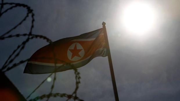 A North Korean flag waves at North Korean Embassy in Kuala Lumpur, Malaysia, Saturday, Feb. 25, 2017. (AP Photo/Daniel Chan)