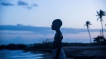 """This image released by A24 Films shows Alex Hibbert in a scene from the film, """"Moonlight."""" The film is nominated for an Oscar for best picture. The 89th Academy Awards will take place on Feb. 26. (David Bornfriend/A24 via AP)"""