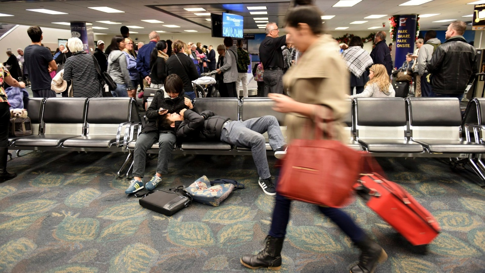 In this file photo, Air Canada passengers pick up their luggage at Terminal 2 at Fort Lauderdale-Hollywood International Airport Sunday, Jan. 8, 2017. (Taimy Alvarez / South Florida Sun-Sentinel via AP)