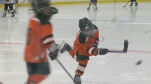 McKnight Hockey Association players on the ice in Huntington Hills on Saturday morning