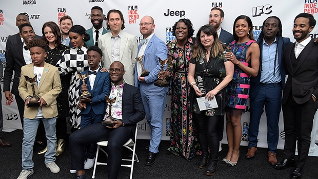 """The cast and crew of """"Moonlight"""" pose in the press room with their awards for best feature at the Film Independent Spirit Awards on Saturday, Feb. 25, 2017, in Santa Monica, Calif. (Photo by Richard Shotwell/Invision/AP)"""