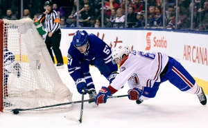 Toronto Maple Leafs' Jake Gardiner (51) gives chase as Montreal Canadiens' Artturi Lehkonen (62) dives for control of the puck during third period NHL action, in Toronto on Saturday, February 25, 2017. THE CANADIAN PRESS/Frank Gunn