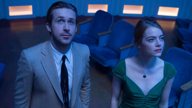 """This image released by Lionsgate shows Ryan Gosling, left, and Emma Stone in a scene from, """"La La Land."""" From a jazzy Ryan Gosling to a Montreal team behind """"Arrival"""" and a trio of animators, there's a healthy dose of Canuck amongst this year's Oscar nominees. THE CANADIAN PRESS/AP, Dale Robinette, Lionsgate"""