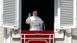Pope Francis delivers his blessing during the Angelus noon prayer he delivered from his studio's window overlooking St. Peter's Square, at the Vatican, Sunday, Feb. 26, 017. (AP Photo/Gregorio Borgia)