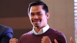 Filipino boxer Manny Pacquiao poses for fans during a meeting with fans in Seoul, South Korea, Saturday, Dec. 24, 2016. (AP Photo/Lee Jin-man)