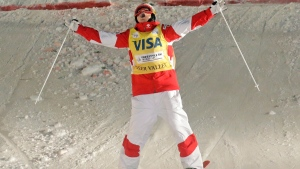 First-place finisher Mikael Kingsbury, of Canada, celebrates as he crosses the finish during the men's dual moguls at the World Cup freestyle skiing competition at Deer Valley resort Saturday, Feb. 4, 2017, in Park City, Utah. (AP Photo/Rick Bowmer)