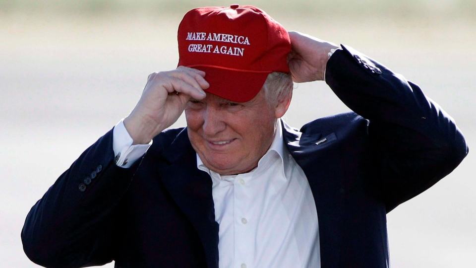 "In this June 1, 2016, file photo, Republican presidential candidate Donald Trump wears his ""Make America Great Again"" hat at a rally in Sacramento, Calif. (THE CANADIAN PRESS/AP/Jae C. Hong, File)"