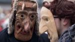 Revellers wearing masks take part in the International Mask Festival in Riga, Latvia, Sunday, Feb. 26, 2017. (AP Photo/Mindaugas Kulbis)