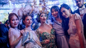 "Guests attend the ""Grand Bal Christian Dior"" during the 2017 spring/summer Haute Couture fashion week, Monday Jan. 23, 2017 in Paris. (AP Photo/Zacharie Scheurer)"