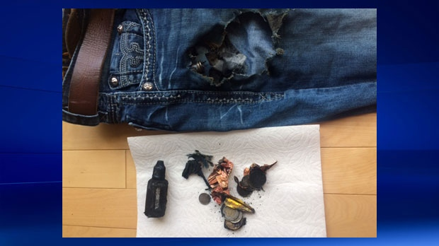 Damage to Terrence Johnson's jeans, charred coins and an e-cigarette liquid bottle (supplied)