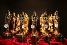 Oscar statues lined up backstage during the Oscars in Los Angeles.  (Photo by Matt Sayles/Invision/AP, File)