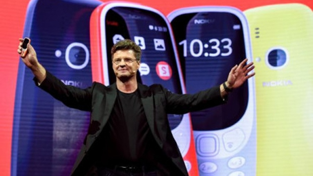 """HMD global CEO Arto Nummela presents his company's new phone """"Nokia 3310"""" during a press conference on February 26, 2017 on the eve of the start of the Mobile World Congress. JOSEP LAGO / AFP"""