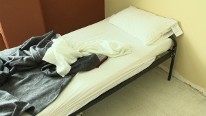 Asylum seekers awaiting hearings fill shelters