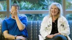 Dr. Colleen Coleman, right, laughs with at Dr. Brian Dunn as they reunite at Hoag Hospital in Newport Beach, Calif., for the first time since she donated her kidney to him, in this photo taken on Feb. 23, 2017. (Cindy Yamanaka / The Orange County Register)