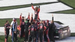 Kurt Busch, top, celebrates with crew members after winning the NASCAR Daytona 500 auto race at Daytona International Speedway in Daytona Beach, Fla., Sunday, Feb. 26, 2017. (AP Photo/David Graham)