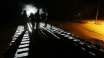 Migrants from Somalia cross into Canada from the United States by walking down a train track into the town of Emerson, Manitoba, where they will seek asylum at the Canada Border Services Agency, early Sunday, Feb. 26, 2017. (John Woods / THE CANADIAN PRESS)