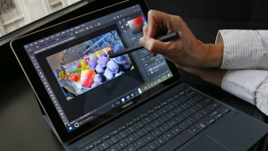 A user demonstrates an S Pen stylus while cropping a photograph on Samsung's 12-inch Galaxy notebook running Windows 10 during a press briefing in New York on Tuesday, Feb. 21, 2017. (AP / Kathy Willens)