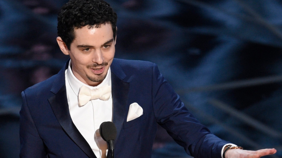 """Damien Chazelle accepts the award for best director for """"La La Land"""" at the Oscars on Sunday, Feb. 26, 2017, at the Dolby Theatre in Los Angeles. (Photo by Chris Pizzello/Invision/AP)"""