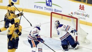 Nashville Predators left wing Viktor Arvidsson, upper left, scores a goal against Edmonton Oilers goalie Cam Talbot during the third period of an NHL hockey game in Nashville, Tenn. on Sunday, Feb. 26, 2017. (AP / Mark Zaleski)