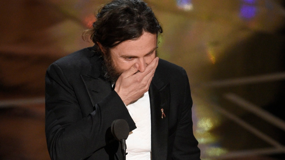 """Casey Affleck reacts as he walks on stage to accept the award for best actor in a leading role for """"Manchester by the Sea"""" at the Oscars on Sunday, Feb. 26, 2017, at the Dolby Theatre in Los Angeles. (Photo by Chris Pizzello/Invision/AP)"""