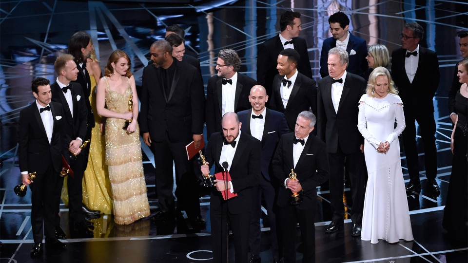 """Fred Berger, foreground center, and the cast of """"La La Land"""" mistakenly accept the award for best picture at the Oscars on Sunday, Feb. 26, 2017, at the Dolby Theatre in Los Angeles. The actual winner of best picture went to """"Moonlight."""" (Photo by Chris Pizzello/Invision/AP)"""
