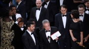 "Presenter Warren Beatty shows the envelope with the actual winner for best picture as host Jimmy Kimmel, left, looks on at the Oscars on Sunday, Feb. 26, 2017, at the Dolby Theatre in Los Angeles. The winner was originally announced as ""La La Land,"" but was later corrected to ""Moonlight."" (Photo by Chris Pizzello/Invision/AP)"