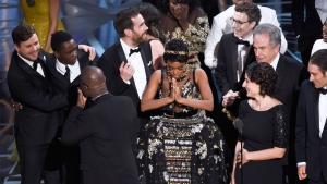 "Janelle Monae, center, reacts as ""Moonlight"" is announced as the winner of best picture at the Oscars on Sunday, Feb. 26, 2017, at the Dolby Theatre in Los Angeles. (Photo by Chris Pizzello/Invision/AP)"