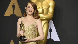 Emma Stone poses in the press room with the award for best actress in a leading role for 'La La Land' at the Oscars at the Dolby Theatre in Los Angeles on Sunday, Feb. 26, 2017. (Jordan Strauss / Invision)