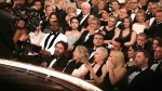 Audience reacts to 'Moonlight' being announced as best picture winner at the Oscars on Feb. 26, 2017, at the Dolby Theatre in Los Angeles. (Matt Sayles / Invision / AP)