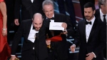 Jordan Horowitz, producer of 'La La Land,' shows the envelope revealing 'Moonlight' at the Oscars on Feb. 26, 2017. (Chris Pizzello / Invision / AP)