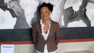 Rachel Dolezal, a leader of the Human Rights Education Institute, stands in front of a mural she painted at the institute's offices in Coeur d'Alene, Idaho on July 24, 2009. (Nicholas K. Geranios/AP)