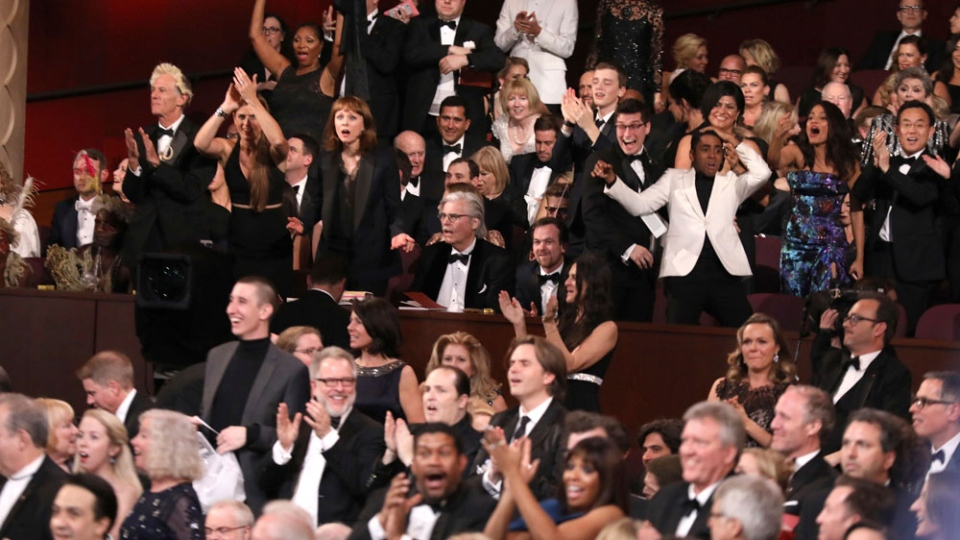 The cast of 'Moonlight' celebrates as 'Moonlight' wins the best picture award at the Oscars on Sunday, Feb. 26, 2017, at the Dolby Theatre in Los Angeles. (Photo by Matt Sayles/Invision/AP)