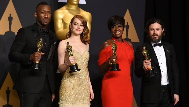 "Mahershala Ali, winner of the award for best actor in a supporting role for ""Moonlight"", from left, Emma Stone, winner of the award for best actress in a leading role for ""La La Land"", Viola Davis, winner of the award for best actress in a supporting role for ""Fences"", and Casey Affleck, winner of the award for best actor in a leading role for ""Manchester by the Sea"", pose in the press room at the Oscars on Sunday, Feb. 26, 2017, at the Dolby Theatre in Los Angeles. (Photo by Jordan Strauss/Invision/AP)"