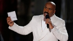 Steve Harvey holds up the card showing the winners after he incorrectly announced Miss Colombia as the winner at the Miss Universe pageant Dec. 20, 2015, in Las Vegas. (John Locher/The Canadian Press)