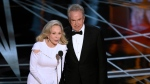 Faye Dunaway, left, and Warren Beatty present the award for best picture at the Oscars on Sunday, Feb. 26, 2017, at the Dolby Theatre in Los Angeles. (Chris Pizzello/Invision/AP)
