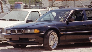 The black BMW, riddled with bullet holes, is seen in a Las Vegas police impound lot, on Sept. 8, 1996. (Lennox McLendon / AP)
