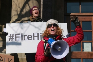 Hope Jamieson Baggs (rear) and Kelly Hickey take part in a rally at police headquarters in St. John's following a weekend of outrage after a Newfoundland officer was acquitted of sexual assault on February 27, 2017. (Paul Daly / THE CANADIAN PRESS)