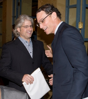 In this file photo, Montreal Alouettes head coach Marc Trestman, right, shares a laugh with general manager Jim Popp during a luncheon Wednesday, Jan. 9, 2008 in Montreal. (Paul Chiasson / THE CANADIAN PRESS)