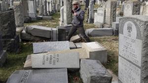 Rabbi Joshua Bolton of the University of Pennsylvania's Hillel Center surveys damaged headstones at Mount Carmel cemetery Monday, Feb. 27, 2017, in Philadelphia. (Jacqueline Larma/THE ASSOCIATED PRESS)
