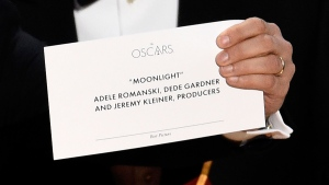 "Jordan Horowitz holds up the envelope that reveals ""Moonlight"" as the true winner of the award for best picture at the Oscars on Sunday, Feb. 26, 2017, at the Dolby Theatre in Los Angeles. (Photo by Chris Pizzello/Invision/AP)"