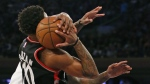 Toronto Raptors guard DeMar DeRozan tries to hold onto the ball after New York Knicks centre Kyle O'Quinn, left, (whose hands are visible at right) nearly knocked it from his hands, in the first half of an NBA basketball game at Madison Square Garden in New York on Monday, Feb. 27, 2017. (AP / Kathy Willens)