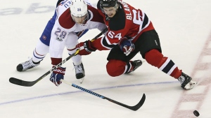 Montreal Canadiens defenceman Nathan Beaulieu (28) and Devils left wing Joseph Blandisi (64) vie for the puck during the second period of an NHL hockey game, Monday, Feb. 27, 2017, in Newark, N.J. (AP Photo/Mel Evans)