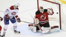 Montreal Canadiens right wing Alexander Radulov, (47) of Russia, watches the puck go in the net for the winning goal past New Jersey Devils goalie Cory Schneider (35) during overtime in an NHL hockey game Monday, Feb. 27, 2017, in Newark, N.J. The Canadiens won 4-3 in overtime. (AP Photo/Mel Evans)