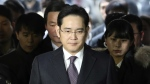 In this Jan. 18, 2017, file photo, Lee Jae-yong, front, a vice chairman of Samsung Electronics Co. arrives for the hearing at the Seoul Central District Court in Seoul, South Korea. (AP / Lee Jin-man, File)