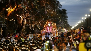 A flat follows a marching band during the Krewe of Bacchus Mardi Gras parade in New Orleans, Sunday, Feb. 26, 2017. (AP / Gerald Herbert)